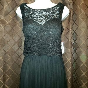 Gorgeous lace top flowing black gown. 10.